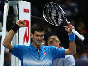 Djokovic cruises through Finals opener
