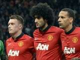 Jones, Felliani and Ferdinand line up for a photograph before the start of the UEFA Champions League quarter-final first leg football match between Manchester United and Bayern Munich at Old Trafford in Manchester on April 1, 2014.