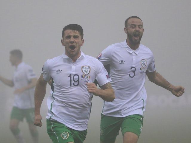 Robbie Brady (C) of Ireland celebrates scoring a goal during the EURO 2016 Qualifier Play-Off First Leg match at Bilino Polje Stadium on November 13, 2015 in Zenica, Bosnia and Herzegovina.