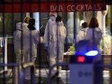 Forensic specialists arrive at the Stade de France on November 13, 2015
