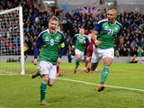 Steve Davis (L) of Northern Ireland celebrates after scoring during the international football friendly match between Northern Ireland and Latvia at Windsor Park on November 13, 2015 in Belfast, Northern Ireland.
