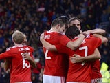 Wales players celebrate the goal scored by Wales's midfielder Joe Ledley to equalise 1-1 during the international friendly football match between Wales and Netherlands at Cardiff City Stadium in south Wales on November 13, 2015.