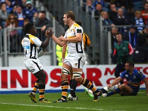 Christian Wade of Wasps (L) celebrates scoring a try with Joe Launchbury during the European Rugby Champions Cup match between Leinster Rugby and Wasps at the RDS Arena on November 15, 2015