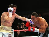 Anthony Crolla (L) and Darleys Perez during their WBA World Lightweight Championship bout at the Manchester Arena on November 21, 2015 in Manchester, England.