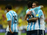 Argentina's Lucas Biglia (R) celebrates with Ezequiel Lavezzi after scoring against Colombia during their Russia 2018 FIFA World Cup South American Qualifiers football match, in Barranquilla on November 17, 2015
