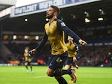 Olivier Giroud of Arsenal celebrates scoring his team's first goal during the Barclays Premier League match between West Bromwich Albion and Arsenal at The Hawthorns on November 21, 2015