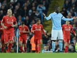 Manchester City's French defender Bacary Sagna (2nd R) gestures after team-mate French defender Eliaquim Mangala (not pictured) scored an own goal during the English Premier League football match between Manchester City and Liverpool at The Etihad stadium