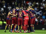 Barcelona's players celebrate during the Spanish league 'Clasico' football match Real Madrid CF vs FC Barcelona at the Santiago Bernabeu stadium in Madrid on November 21, 2015.