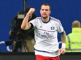 Hamburg's forward Pierre-Michel Lasogga celebrates scoring a penalty during the German first division football Bundesliga match between Hamburg SV and Borussia Dortmund in Hamburg, northern Germany on November 20, 2015.