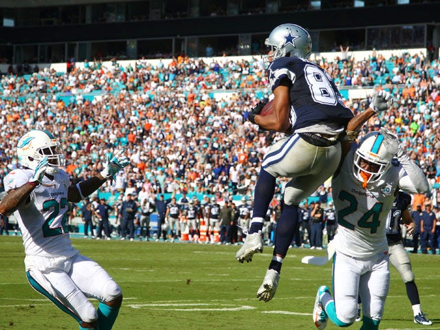 Terrance Williams #83 of the Dallas Cowboys catches a touchdown pass as Jamar Taylor #22 and Brice McCain #24 of the Miami Dolphins look on during the second quarter of the game at Sun Life Stadium on November 22, 2015