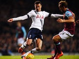 Dele Alli of Tottenham Hotspur takes on Mark Noble of West Ham United during the Barclays Premier League match between Tottenham Hotspur and West Ham United at White Hart Lane on November 22, 2015 in London, England.