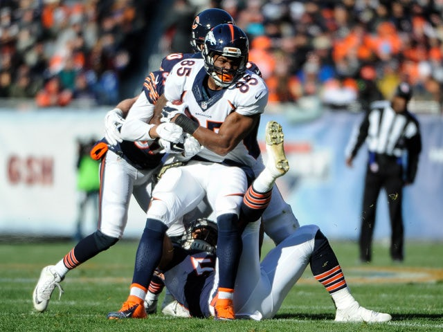 Virgil Green #85 of the Denver Broncos carries the football against the Chicago Bears in the first quarter at Soldier Field on November 22, 2015