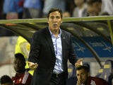 Celta Vigo's Argentinian coach Eduardo Berizzo (L) gestures during the Spanish league football match Celta Vigo vs FC Barcelona at the Balaidos stadium in Vigo on September 23, 2015