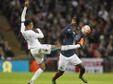 England's midfielder Dele Alli (L) vies against France's midfielder Blaise Matuidi during the friendly football match between England and France at Wembley Stadium in west London on November 17, 2015
