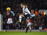Eric Dier of Tottenham Hotspur is challenged by Manuel Lanzini of West Ham United during the Barclays Premier League match between Tottenham Hotspur and West Ham United at White Hart Lane on November 22, 2015 in London, England.