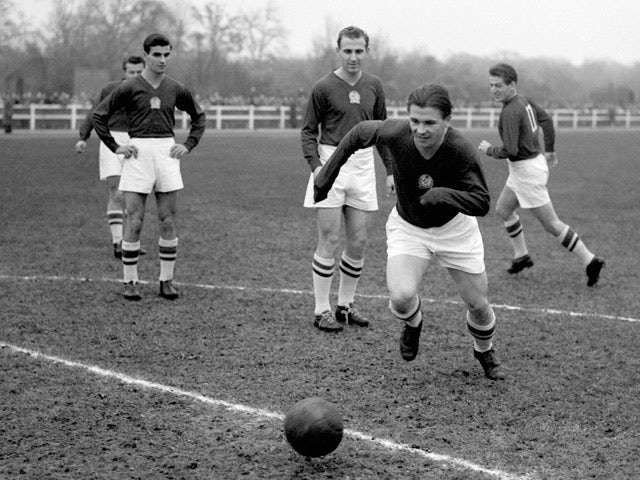 A file picture taken 21 November 1953 shows Hungarian football legend Ferenc Puskas (C) training with French car maker Renault workers in the western Paris suburb of Boulogne-Billancourt ahead of the match opposing Hungary to England at Wembley