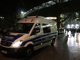 Police survey the entrance of the stadium as supporters leave the HDI Arena after the friendly football match Germany vs the Netherlands was called off for 'security reasons' in Hannover on November 17, 2015