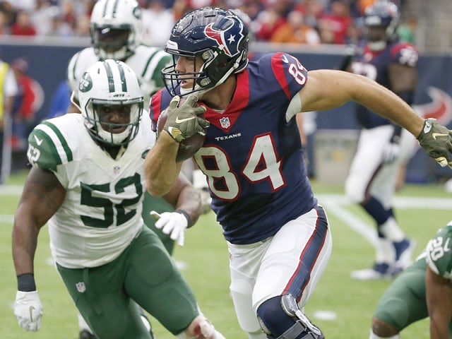 Ryan Griffin #84 of the Houston Texans runs against David Harris #52 of the New York Jets in the second quarter on November 22, 2015