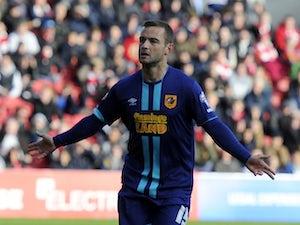 Maloney earns Hull draw at Bristol City