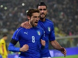 Italy's midfielder Claudio Marchisio (L) celebrates with Italy's forward Graziano Pelle (R) after scoring a penalty during the friendly football match between Italy and Romania, on November 17, 2015