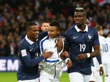 Jesse Lingard of England is greeted by Patrice Evra and Paul Pogba of France prior to the International Friendly match between England and France at Wembley Stadium on November 17, 2015