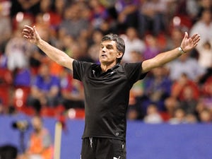 Eibar's coach Jose Luis Mendilibar gestures during the Spanish league football match Levante UD vs SD Eibar at the Ciutat de Valencia stadium in Valencia on September 23, 2015