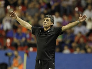 Eibar's coach Jose Luis Mendilibar gestures during the Spanish league football match Levante UD vs SD Eibar at the Ciutat de Valencia stadium in Valencia on September 23, 2015