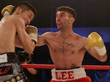 Lee Haskins of Great Britain and Ryosuke Iwasa of Japan exchange blows during their Interim IBF World Bantamweight Title Fight at Action Indoor Sports Arena on June 13, 2015 in Bristol, England.