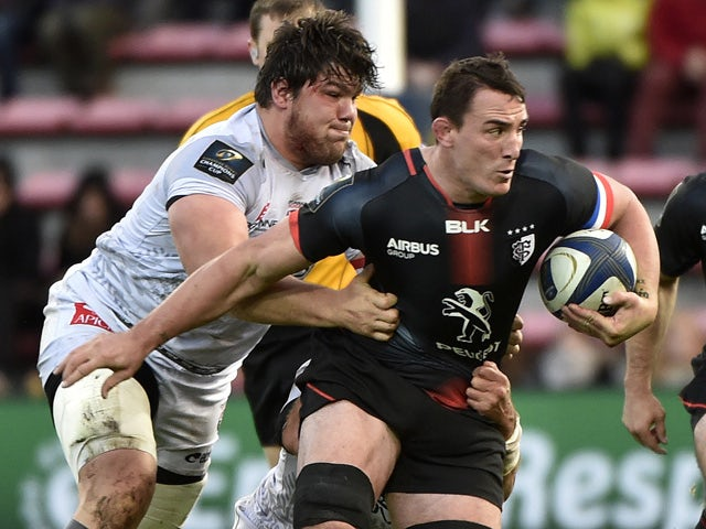 Toulouse's French number eight Louis Picamoles (R) breaks away from Oyonnax' French prop Antoine Guillamont during the European Rugby Union Champions Cup match Toulouse against Oyonnax on November 21, 2015