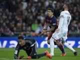 Luis Suarez of FC Barcelona celebrates scoring their opening goal during the La Liga match between Real Madrid CF and FC Barcelona at Estadio Santiago Bernabeu on November 21, 2015 in Madrid, Spain.