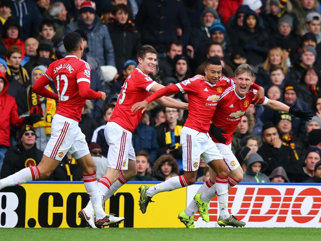 Bastian Schweinsteiger of Manchester United celebrates his team's second goal scored by Troy Deeney of Watford with his team mates during the Barclays Premier League match between Watford and Manchester United at Vicarage Road on November 21, 2015