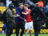 Manager Louis van Gaal (2nd L) and Bastian Schweinsteiger (2nd R) of Manchester United celebrate their 2-1 win in the Barclays Premier League match between Watford and Manchester United at Vicarage Road on November 21, 2015