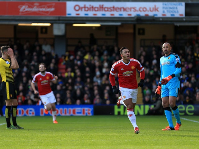 Memphis Depay (2nd R) of Manchester United celebrates scoring his team's first goal during the Barclays Premier League match between Watford and Manchester United at Vicarage Road on November 21, 2015