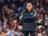 Manuel Pellegrini, manager of Manchester City looks on during the Barclays Premier League match between Manchester City and Liverpool at Etihad Stadium on November 21, 2015 in Manchester, England.