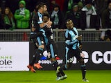 Marseille's French midfielder Georges-Kevin Nkoudou (R) celebrates with teammates Marseille's Ivorian defender Brice Djadjedje (C) and Marseille's Chilian midfielder Mauricio Anibal Isla (L) after scoring a goal during the French Ligue 1 football match be