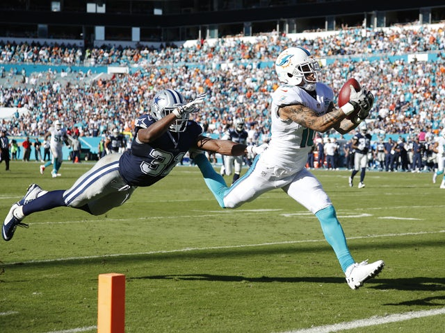 Kenny Stills #10 of the Miami Dolphins makes a 29-yard touchdown reception against Byron Jones #31 of the Dallas Cowboys in the third quarter of the game at Sun Life Stadium on November 22, 2015