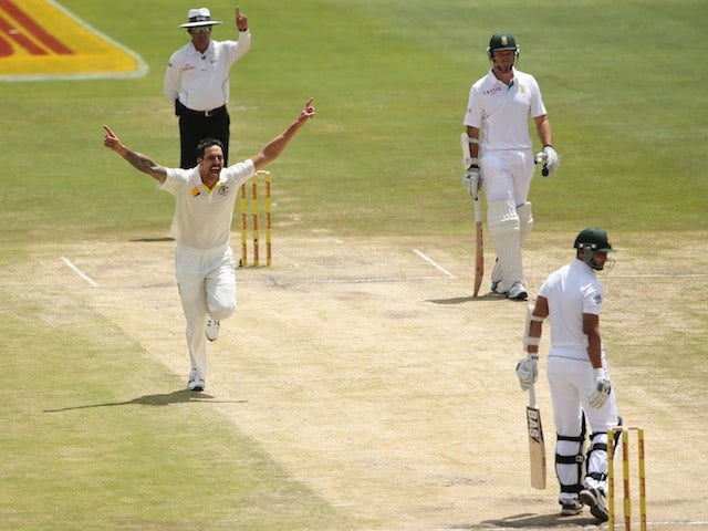 Mitchell Johnson takes a wicket during the first Test against South Africa on February 15, 2014