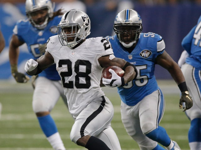 Latavius Murray #28 of the Oakland Raiders runs a second quarter reception while playing the Detroit Lions at Ford Field on November 22, 2015