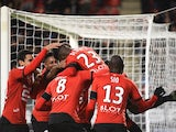 Rennes' French forward Ousmane Dembele (top) celebrates after scoring during the French L1 football match Rennes against Bordeaux on November 22, 2015 at the route de Lorient stadium in Rennes, western France.