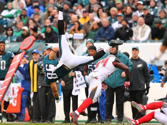 Zach Ertz #86 of the Philadelphia Eagles flies through the air as he makes a reception against Lavonte David #54 of the Tampa Bay Buccaneers in the second quarter at Lincoln Financial Field on November 22, 2015
