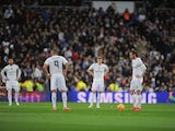Gareth Bale of Real Madrid reacts after Barcelona scored their opening goal after scoring his team's opening goal during the La Liga match between Real Madrid and Barcelona at Estadio Santiago Bernabeu on November 21, 2015 in Madrid, Spain.