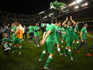 Republic of Ireland players celebrate after securing their place at the Euro 2016 finals on November 16, 2015