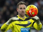 Newcastle United's English-born Irish goalkeeper Rob Elliot gathers the ball during the English Premier League football match between Newcastle United and Leicester City at St James' Park in Newcastle-upon-Tyne, north east England, on November 21, 2015. L