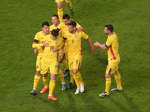 Italy held to draw by Romania