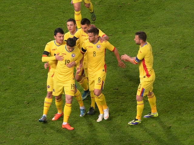 Bogdan Stancu #19 of Romania celebrates after scoring his opening goal during the international friendly match between Italy and Romania at Stadio Renato Dall'Ara on November 17, 2015