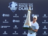 Rory McIlroy of Northern Ireland Rory McIlroy of Northern Ireland poses with the Race To Dubai trophy following the final round of the DP World Tour Championship on the Earth Course at Jumeirah Golf Estates on November 22, 2015 in Dubai, United Arab Emira