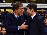 West Ham United's Croatian manager Slaven Bilic (L) greets Tottenham Hotspur's Argentinian Head Coach Mauricio Pochettino (R) ahead of the English Premier League football match between Tottenham Hotspur and West Ham United at White Hart Lane in north Lond