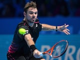 Switzerland's Stanislas Wawrinka returns the ball to Spain's Rafael Nadal during their men's singles group stage match on day two of the ATP World Tour Finals tennis tournament in London on November 16, 2015