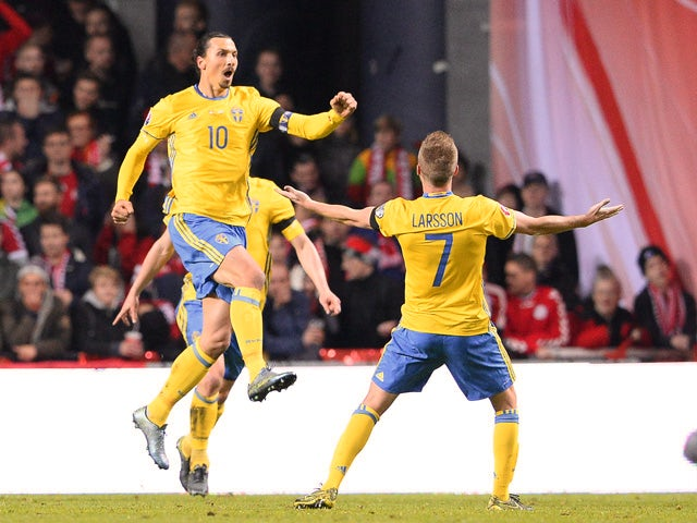 Sweden's forward and team captain Zlatan Ibrahimovic (L) celebartes after scoring a goal during the Euro 2016 second leg play-off football match between Denmark and Sweden at Parken stadium in Copenhagen on November 17, 2015