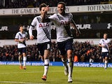 Tottenham Hotspur's English defender Kyle Walker (2nd R) celebrates with Tottenham Hotspur's English midfielder Ryan Mason after scoring their fourth goal during the English Premier League football match between Tottenham Hotspur and West Ham United at Wh
